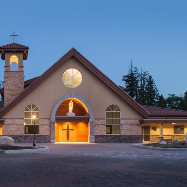 St Clare of Assisi Parish Church Exterior at Dusk by Keystone Architecture