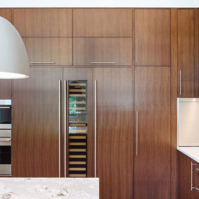 Modern Kitchen with Wood Panelling by Kenorah Design + Build